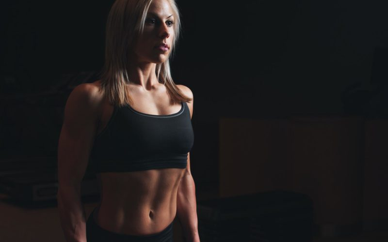 trainer showing tone body for women